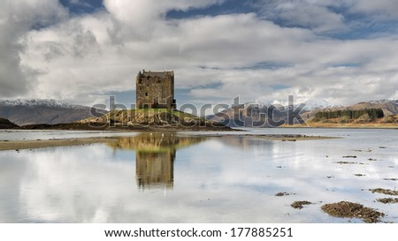 Castle Stalker reflecting on Loch Linnhe in the west coast of Scotland - stock photo