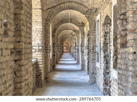 Castle tunnel with a series of arches in the ruined Bastion fortress in the Slovak city of Komarno. - stock photo