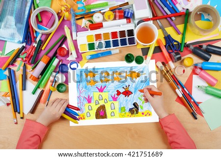 castle under water with treasure, the king fish with crown, fairy tale, child drawing, top view hands with pencil painting picture on paper, artwork workplace - stock photo