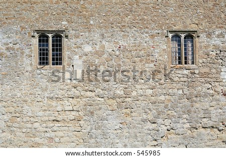 Castle wall with windows - stock photo