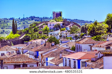 Castle Walls Turrets Towers Medieval Town Obidos Portugal. Castle and walls built in 11th century after town taken from the Moors.