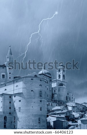 castle with peaks under the rain  in Urbino - stock photo