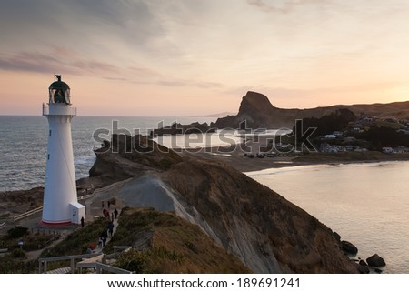 Castlepoint Lighthouse look out over the small bay that fishing boats go out. - stock photo