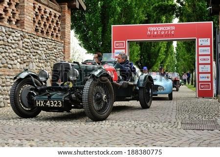 CASTREZZATO, ITALY - APRIL 12: A green Aston Martin MK2 finishes the Franciacorta Historic classic car race on April 12, 2014 in Castrezzato. This car was built in 1935. - stock photo