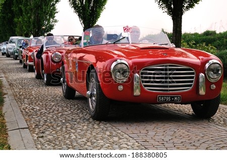 CASTREZZATO, ITALY - APRIL 12: A red Siata Daina Gran Sport, Triumph TR2 and more take part to the Franciacorta Historic car race on April 12, 2014 in Castrezzato. The car were built in 1952 and 1955. - stock photo