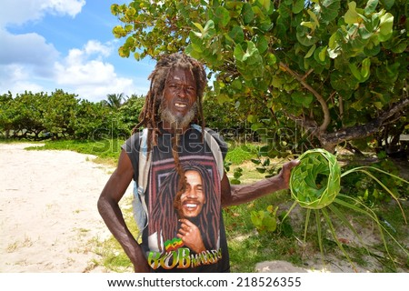 CASTRIES, ST. LUCIA, SEPTEMBER 16: An unidentified man in St. Lucia making handcraft on SEPTEMBER 16, 2014 in Santa Lucia - stock photo