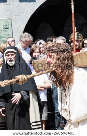 CASTRO URDIALES - SPAIN - APRIL 18: Jesus and the Cross in the living passion of Castro Urdiales celebrated in Castro Urdiales on April 18, 21014 - stock photo