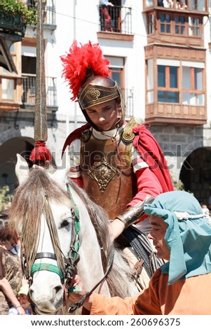CASTRO URDIALES - SPAIN - APRIL 18: Roman Soldier on horseback in the living passion of Castro Urdiales celebrated in Castro Urdiales on April 18, 21014 - stock photo