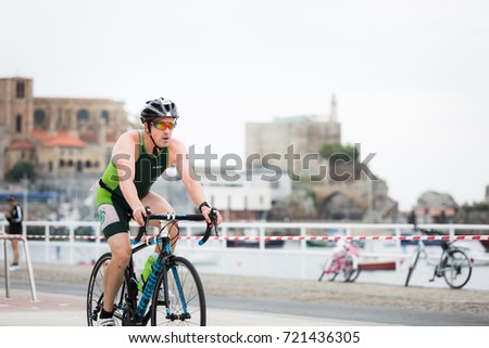 CASTRO URDIALES, SPAIN - AUGUST 27, 2017: Unidentified athlete in the cycling competition during the XXIX Triathlon of Castro Urdiales