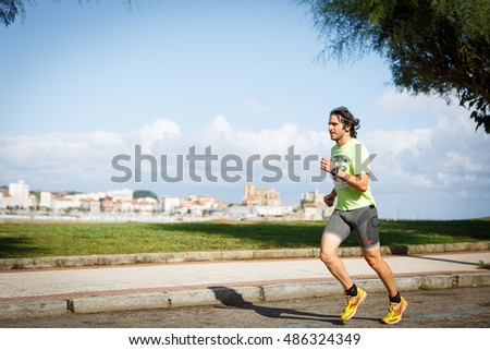CASTRO URDIALES, SPAIN - SEPTEMBER 18: Unidentified athlete in the in the 10km race competition celebrated in Castro Urdiales in September 18, 2016 in Castro Urdiales, Spain