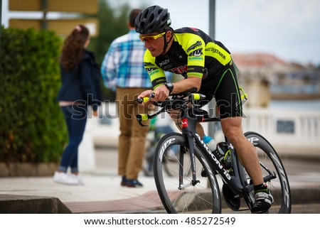 CASTRO URDIALES, SPAIN - SEPTEMBER 17: Unidentified triathlete in the cycling competition celebrated in the triathlon of Castro Urdiales in September 17, 2016 in Castro Urdiales, Spain