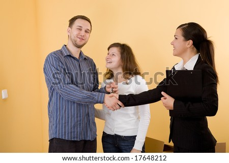 casual and happy couple making transaction - stock photo