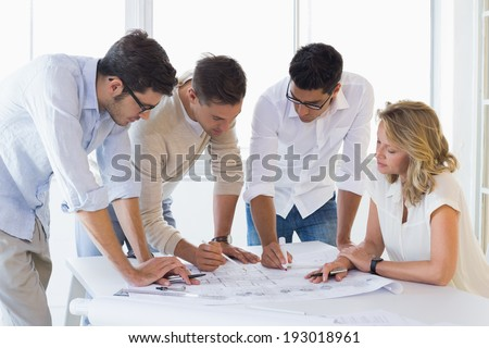 Casual architecture team working together in the office - stock photo