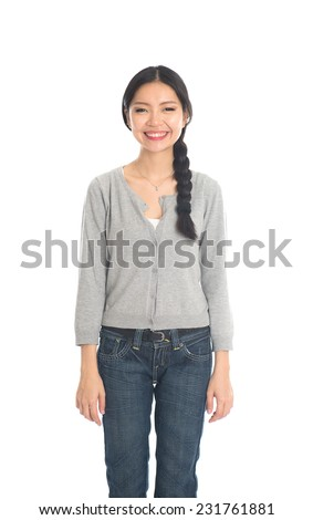 casual asian female with jeans and sweater - stock photo