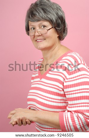 Casual, attractive older woman in her sixties - stock photo