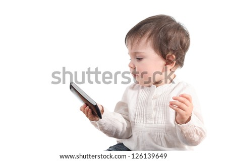 Casual baby watching a mobile phone in a white isolated background - stock photo