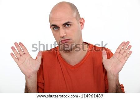 Casual bald man in studio - stock photo