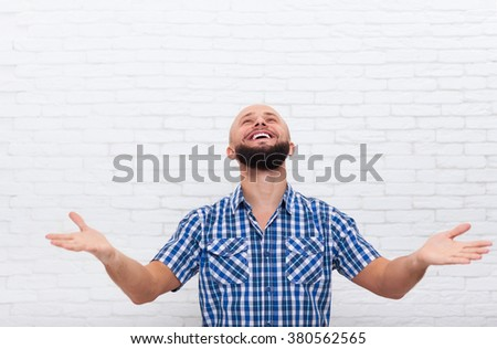 Casual Bearded Business Man Excited Happy Look Up Hand Gesture Office White Brick Wall - stock photo