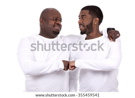 casual black man with son on white studio background