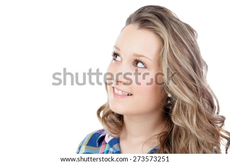 Casual blonde girl looking up isolated on a white background - stock photo