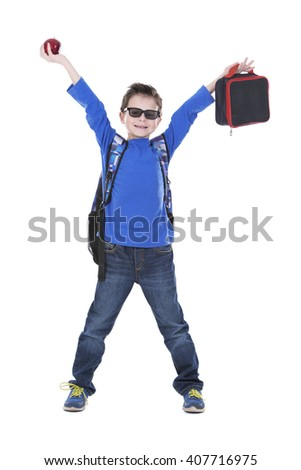 casual boy is holding an apple and school lunch on white background - stock photo