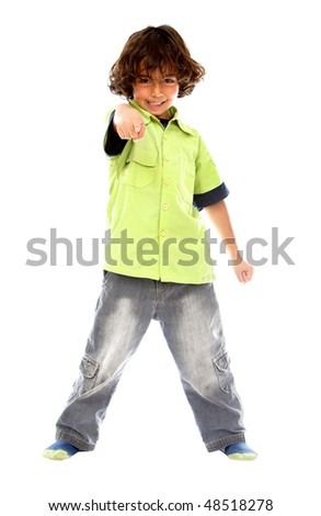 Casual boy pointing at you over a white background
