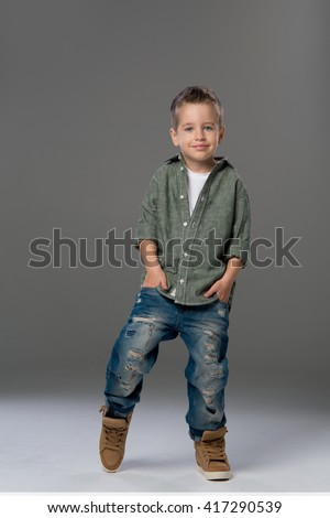 Casual boy with smile over a grey background