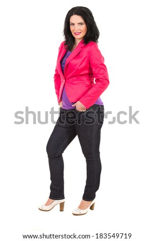 Casual brunette woman standing with hands in pockets jeans in semi profile isolated on white background - stock photo