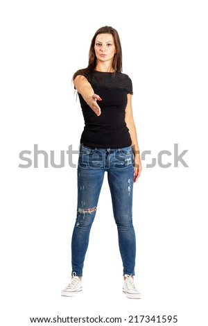 Casual brunette woman with welcome hand for handshake gesture. Full body length isolated over white. - stock photo