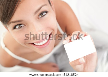 Casual business card woman. High angle view of beautiful mixed race Asian Chinese / Caucasian young woman. - stock photo