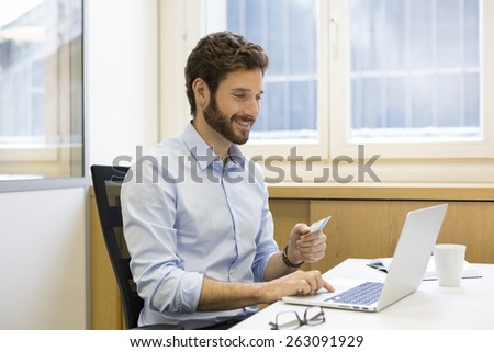 Casual business man paying online with credit card. ecommerce - stock photo