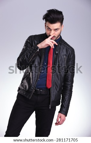 Casual business man wiping his nose while looking at the camera. - stock photo