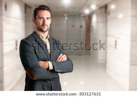 Casual business man with arms crossed  - stock photo