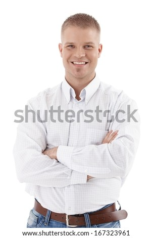 Casual business portrait of handsome man standing with arms crossed, smiling at camera, cutout on white.
