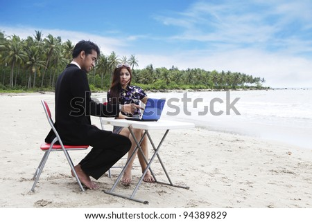 Casual business team meeting on the beach