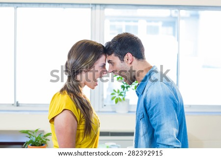 Casual business team yelling at each other in the office - stock photo