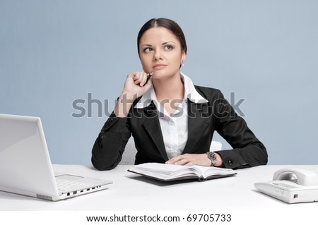 Casual business woman in office working with white table, laptop and diary personal organizer. Idea! - stock photo