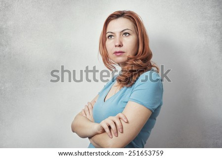 Casual business woman showing power and determination - stock photo