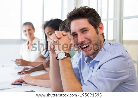 Casual businessman laughing during meeting in the office - stock photo