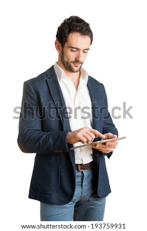 Casual Businessman Looking at a tablet, isolated in white - stock photo