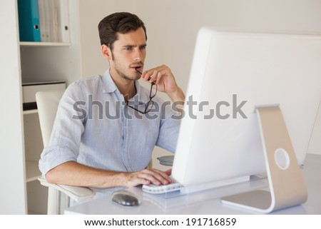Casual businessman working at his desk in his office