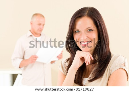 Casual businesswoman attractive smiling portrait businessman in background