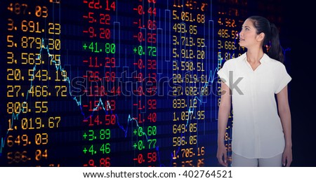 Casual businesswoman looking and smiling against stocks and shares