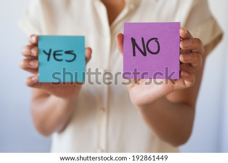 Casual businesswoman showing no card in her office - stock photo
