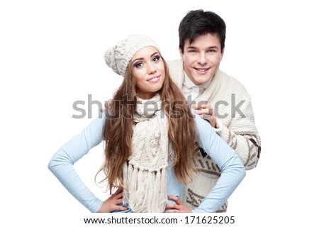 casual caucasian smiling young couple in winter clothing embracing. isolated on white - stock photo
