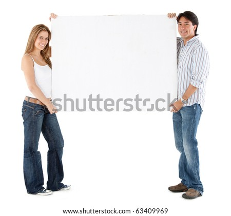 Casual couple holding a banner - isolated over a white background - stock photo