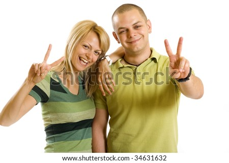 casual couple making their victory sign over white background