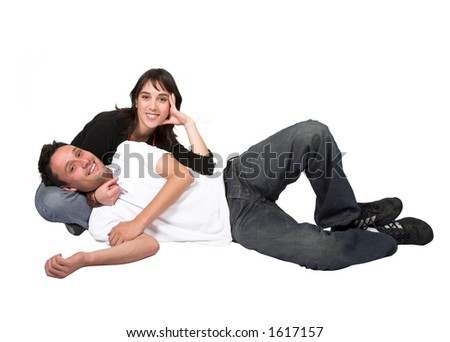 casual couple on the floorover a white background