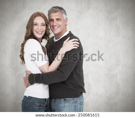 Casual couple smiling at camera against white background
