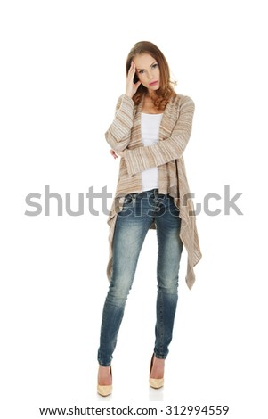 Casual depressed woman holding head. - stock photo